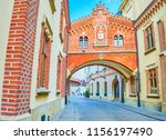 Small photo of KRAKOW, POLAND - JUNE 11, 2018: Historical Pijarska street famous for its edifices such as Czartoryski Museum with its beautiful covered pass across the street, on June 11 in Krakow.2