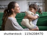 smiling mother hugging cute... | Shutterstock . vector #1156208470
