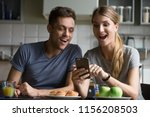 excited young couple surprised... | Shutterstock . vector #1156208503