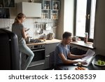 young couple using laptop and...   Shutterstock . vector #1156208539