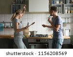funny young couple dancing to... | Shutterstock . vector #1156208569