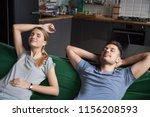 young couple relaxing on... | Shutterstock . vector #1156208593