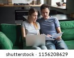 worried couple confused reading ... | Shutterstock . vector #1156208629