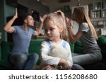 Stock photo kid daughter feels upset while parents fighting at background sad little girl frustrated with 1156208680