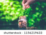 closeup of woman's hand putting ... | Shutterstock . vector #1156219633