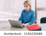 young woman working at office | Shutterstock . vector #1156220680