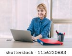 young woman working at office | Shutterstock . vector #1156220683