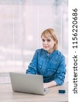 young woman working at office | Shutterstock . vector #1156220686
