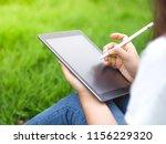 beautiful woman writing into... | Shutterstock . vector #1156229320