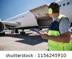 aircraft ground handling. man... | Shutterstock . vector #1156245910