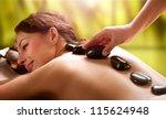 spa hot stone massage | Shutterstock . vector #115624948