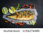 fried fish with lime and herbs... | Shutterstock . vector #1156276480