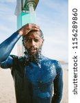 portrait surfer man taking a... | Shutterstock . vector #1156289860