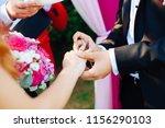wedding rings and hands of... | Shutterstock . vector #1156290103