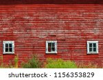 Faded Old Wall Of A Red Barn