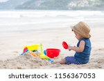asian baby boy playing sand on... | Shutterstock . vector #1156367053