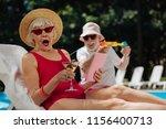 sprinkling water. funny man...   Shutterstock . vector #1156400713