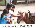 asian children touching and... | Shutterstock . vector #1156417129
