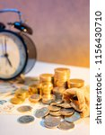 table clock and gold coin stack ... | Shutterstock . vector #1156430710