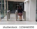 women walking to entrance gate... | Shutterstock . vector #1156460350