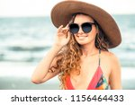 happy young woman wearing... | Shutterstock . vector #1156464433