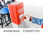 woman at a ticket validator at...   Shutterstock . vector #1156507153