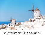view of the village of oia ... | Shutterstock . vector #1156560460
