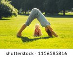 young woman doing yoga with... | Shutterstock . vector #1156585816