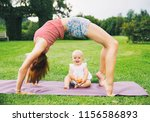 young woman doing yoga with... | Shutterstock . vector #1156586893