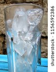 cubes of ice in the glass | Shutterstock . vector #1156592386