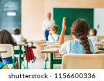 back view of schoolgirl raising ... | Shutterstock . vector #1156600336