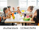 adorable schoolgirls taking... | Shutterstock . vector #1156615696