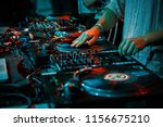 party dj scratches vinyl record ... | Shutterstock . vector #1156675210