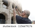 male tourist taking a photo of... | Shutterstock . vector #1156679176