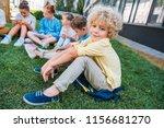 adorable curly schoolboy... | Shutterstock . vector #1156681270