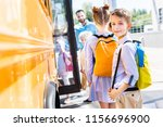 adorable schoolboy entering... | Shutterstock . vector #1156696900