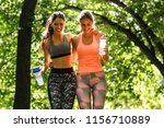 two young female friends... | Shutterstock . vector #1156710889