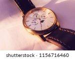 men's gold wristwatch on a...   Shutterstock . vector #1156716460