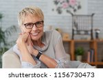 portrait of happy senior woman... | Shutterstock . vector #1156730473
