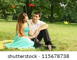 Young couple enjoy each other's company in the park - stock photo