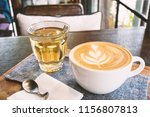 cup of latte art coffee and hot ... | Shutterstock . vector #1156807813