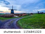 windmill farm road evening... | Shutterstock . vector #1156841323