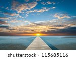 Sunrise Over The Sea With Pier...