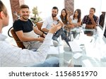 business team sitting at a... | Shutterstock . vector #1156851970