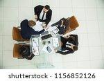 business partners shaking... | Shutterstock . vector #1156852126