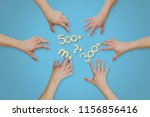 top view of hands reaching for... | Shutterstock . vector #1156856416