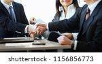 mature businessman shaking... | Shutterstock . vector #1156856773