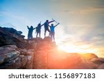 male and female hikers climbing ... | Shutterstock . vector #1156897183