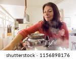 woman cooking in the kitchen.  | Shutterstock . vector #1156898176