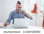 young businessman working on... | Shutterstock . vector #1156928500
